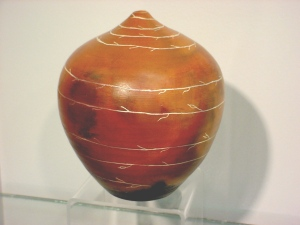 red art pit fired vessel